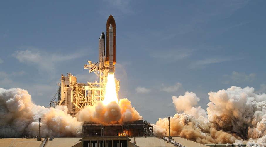 A rocket launching off a pad.