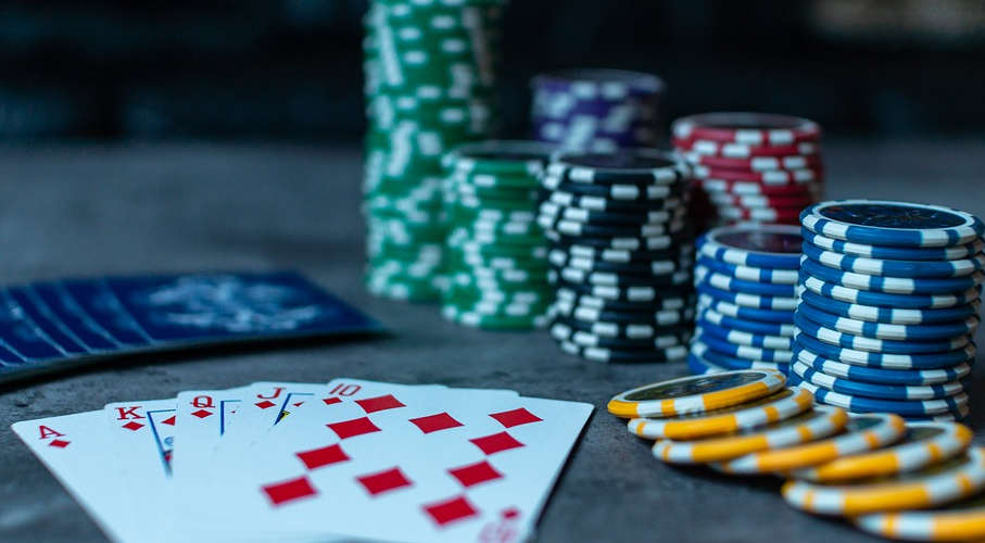 A table with poker cards and chips.