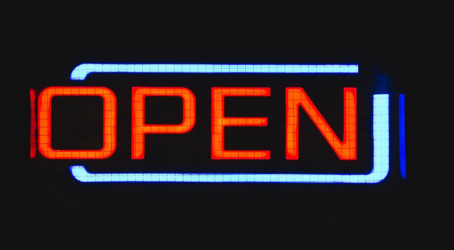A neon-lit open sign