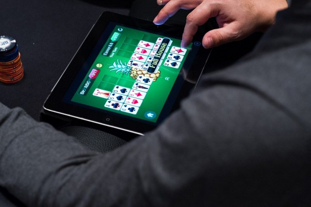 Playing online poker on an Apple iPad.
